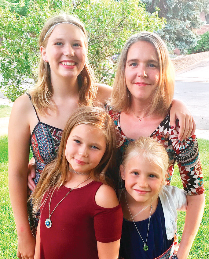 Rebecca Roese, right, says her three daughters have come to see school shootings as normal since the 2013 Arapahoe shooting.