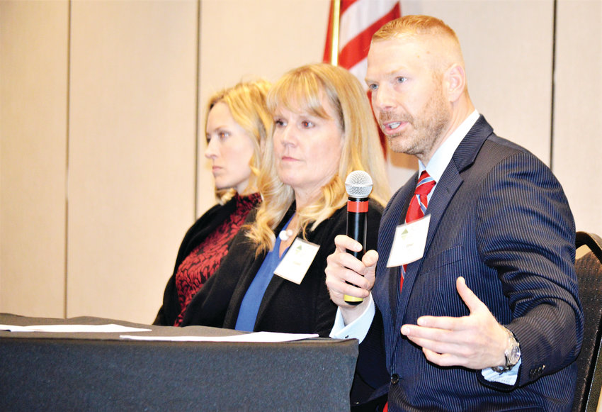 Jesse Ostermick, capital markets director for real estate firm CBRE, state demographer Elizabeth Garner and High Pass Asset Management founder Ethan S. Braid take questions at the end of a luncheon hosted by Adams County Economic Development Dec. 6 in Westminster.