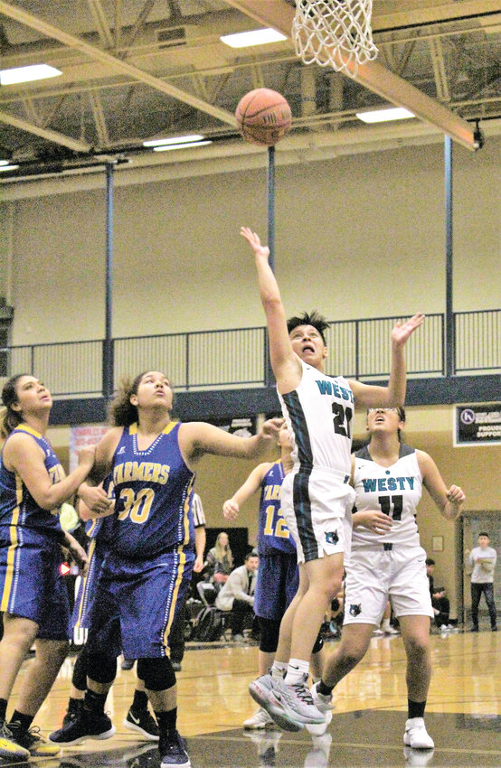 Westy sophomore Lauren Graves Bonilla attempts a layup Dec. 5 in the first round of the Westminster Winter Classic at Westminster High School against Wheat Ridge.