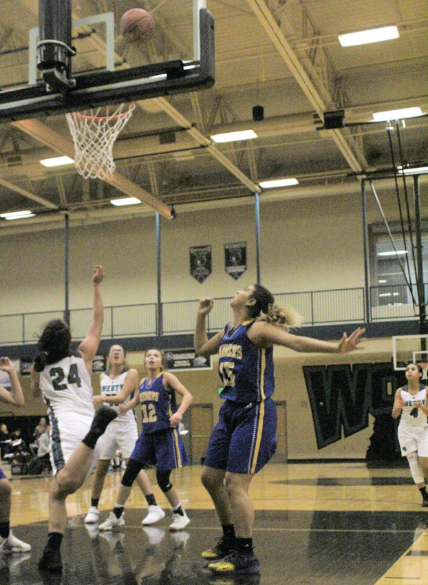 Lady Wolves' junior Valerie Gallegos hits the acrobatic shot against Wheat Ridge Dec. 5 in the first round of the Westminster Winter Classic.