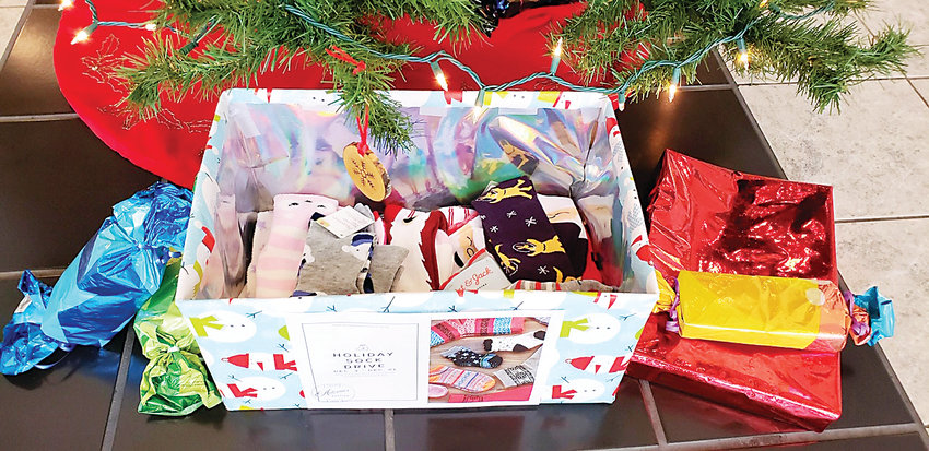 Sock drive: Premier Members Credit Union is collecting socks for local charities, one of three programs the credit union is running this month.