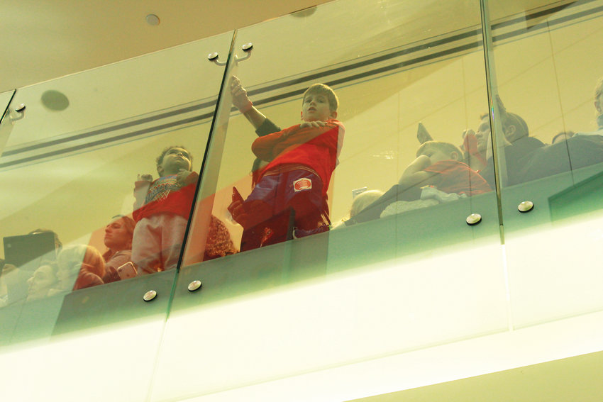 Children watch down from the balconies as Obama enters the lobby of the Children's Hospital Colorado.