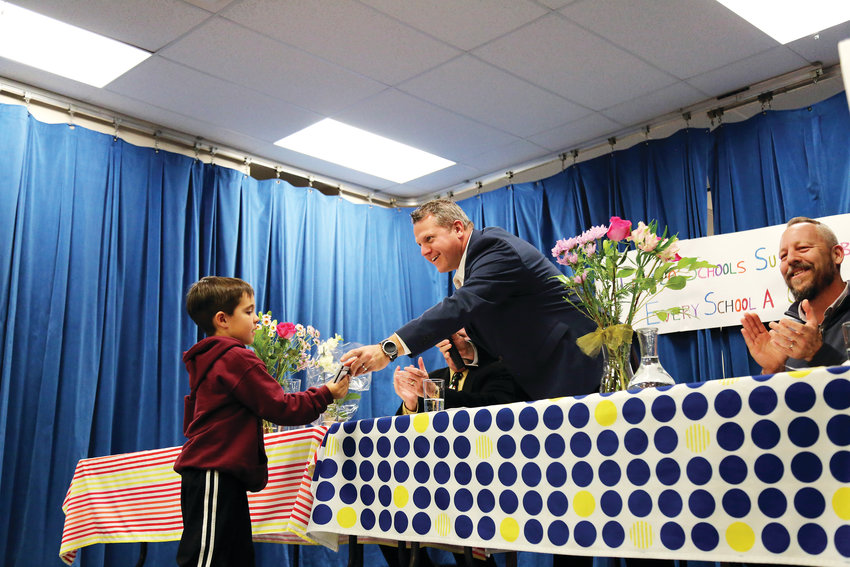 Jeffco schools Superintendent Dr. Jason Glass recognizes kindergartener Marshall Anderson for bringing in markers to be recycled before the initiative was announced.
