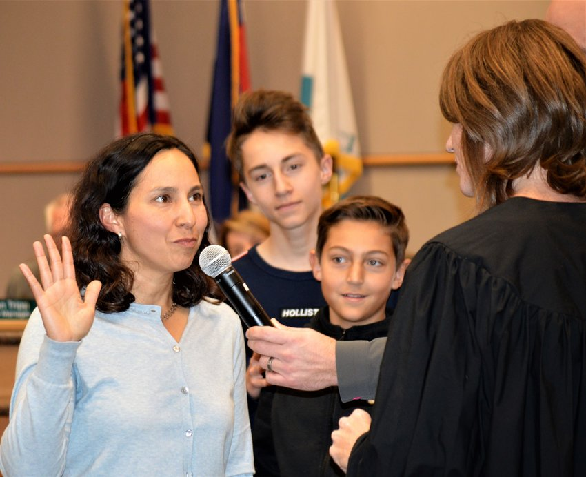 Newly appointed Westminster City Councilor Sheela Mahnke is sworn into office by Municipal Judge Tiffany Sorice at the end the council's Dec. 17 meeting while sons Gibson, 14, and Ryman, 12 , watch. Mahnke was one of 45 candidates interviewed by the City Council to fill a vacant spot.