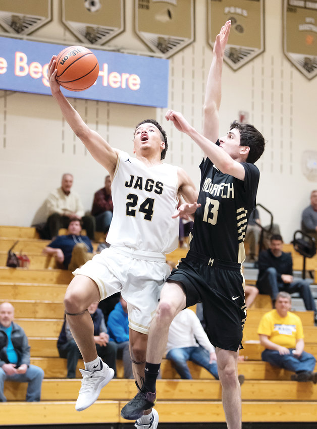 Rock Canyon's Jaylen Eikenberg flies in for the layup as Monarch's Joey Covington looks to get in his way. The Jaguars ended up on top their home court 64-40 on Dec. 14.