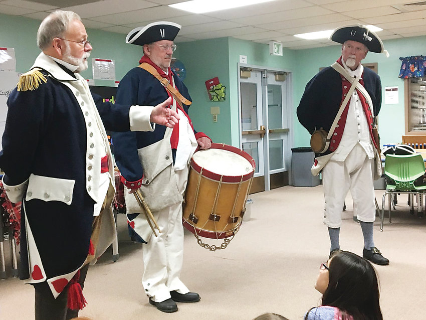From left, Compatriots Robert Hampton, Mike Coyner and Steve DeBoer make Patriot Chest presentations to students at Warder Elementary School.