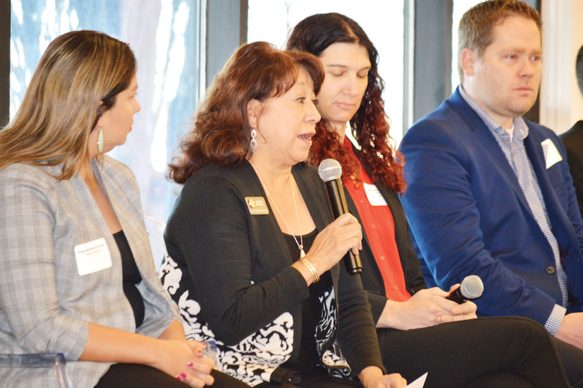 State Representative Adrienne Benavidez talks about her legislative priorities to a breakfast crowd Dec. 11 in the Westminster Recreation Center that was sponsored by the Metro North Chamber of Commerce.