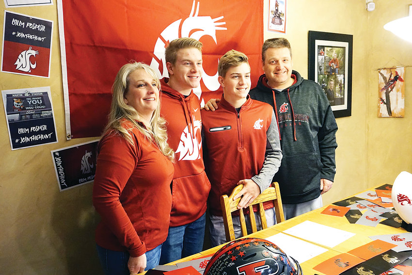 The Pospisil Family — Debbie, Billy, Jack and Bill — celebrated with family and friends early morning on Dec. 19 after Billy signed his National Letter of Intent to continue his football career at Washington State University.