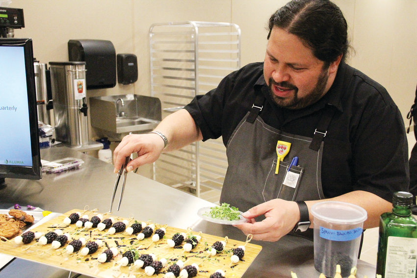 Daniel Asher, a well-known chef in the Denver area, tops food samples Dec. 18 at Alumia Institute, a therapy campus for those in the early stages of dementia, at 9800 E. Geddes Ave. Asher is the chef consultant for the campus and designed its nutritional plan.