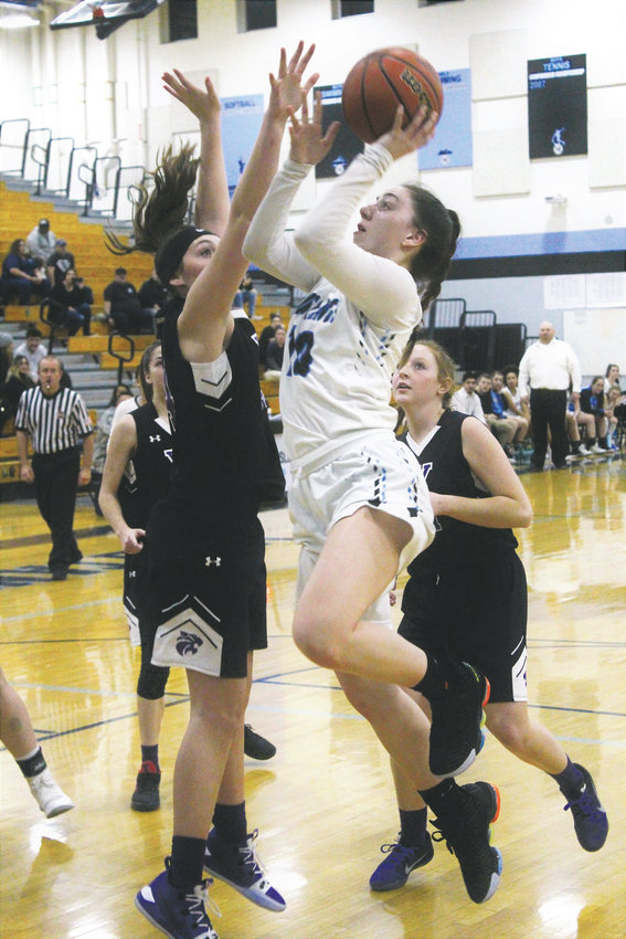 Lady Mustangs' junior Lillian West drives to the basket Dec. 18 at home against Arvada West.