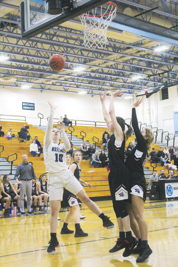 Mountain Range junior Lillian West attempts the layup against Arvada West Dec. 18.