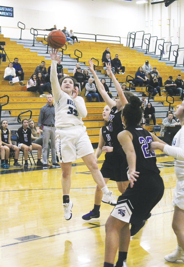 MR senior Anna Giampietro shoots the floater Dec. 18 at home against Arvada West.