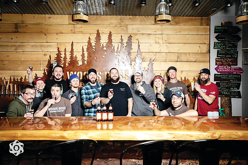 Jordan Fink, front right, co-owner of Woods Boss Brewing Co. pulled together nine other breweries to make the Resilience Butte County Proud IPA. The beer is being sold by breweries nationwide to raise money for Camp Fire relief.