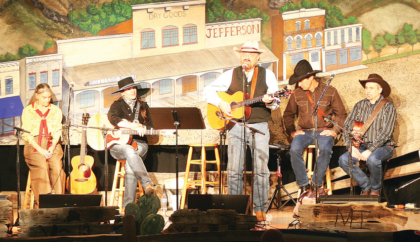 Jon Chandler of Commerce City, center, performs during the 2016 Colorado Cowboy Poetry Gathering. Chandler is one of about 20 artists who will perform at this year's event, which takes place Jan. 18-20 at the American Mountaineering Center in Golden.