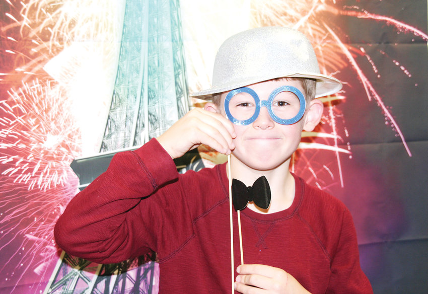 Logan Dowling, 6, of Golden decks himself out in goofy glasses, a bowtie and a shiny hat to welcome the New Year on Dec. 31 at the Golden Library. This year, the library hosted the event at 4 p.m. to ring in the New Year in the French time zone.
