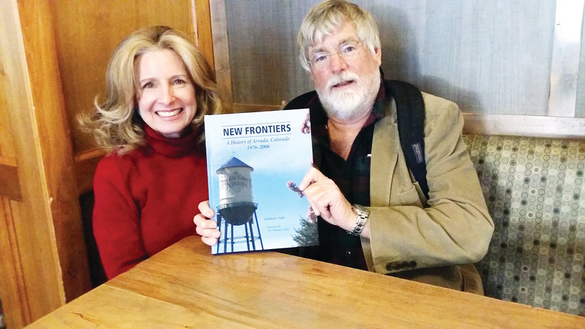 Kim Field and Dr. Thomas J. Noel, Colorado's State Historian, show off Field's new book on Arvada's history from 1976 to 2006.