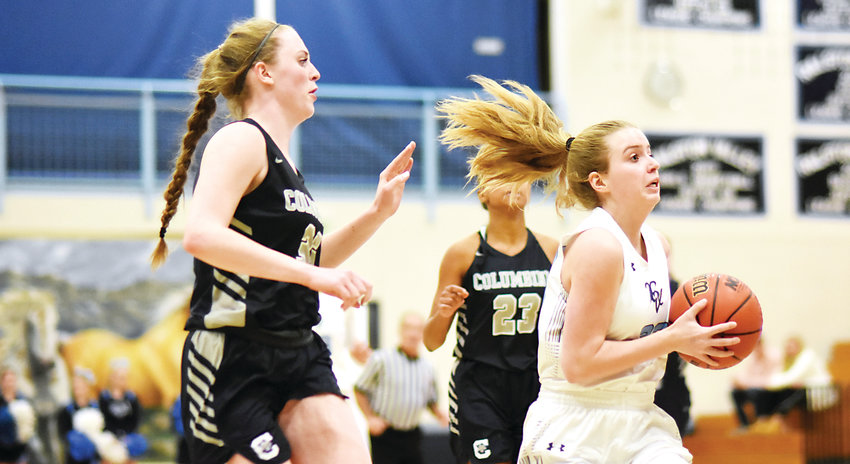 Ralston Valley junior Madison Young, far right, drives to the basket during the Mustangs' 45-35 victory Jan. 5 against Columbine.