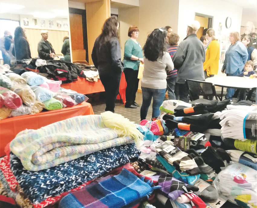 Volunteers talk in a room full of donated goods for homeless individuals January 2018. Adams County will host four similar events Jan. 28 and 29 this year. Jefferson County hosts three this year, and Denver and Araphoe Counties are hosting events as well.