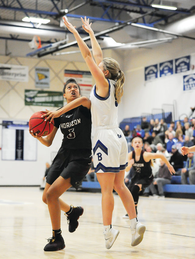 Horizon senior Caleese Ramirez, left, drives against Broomfield's Ellie Keeler, during first quarter action of last Jan. 4th's game at Broomfield High School. The Hawks defeated the Eagles, 46-37.