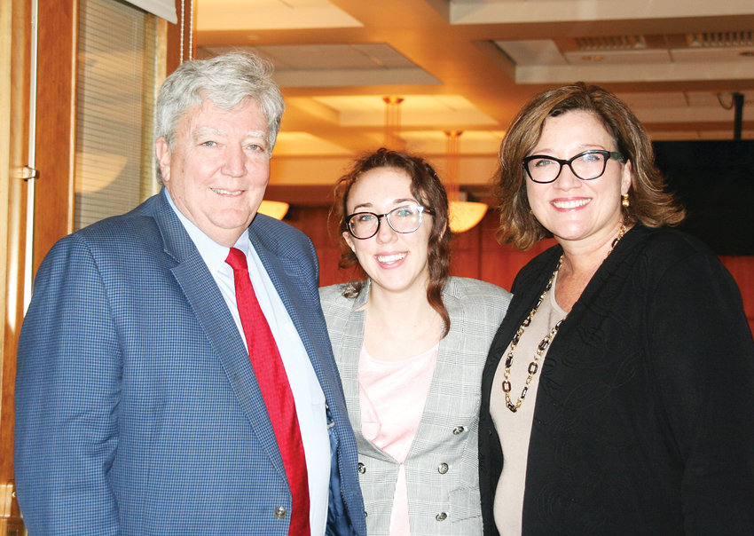 Jefferson County Commissioner Lesley Dahlkemper, far right, has her picture taken with her husband Mike Feeley and daughter Grace Feeley during the reception following the county's swearing in ceremony on Jan. 8.