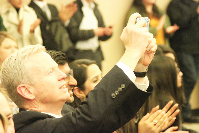 District Attorney George Brauchler, who oversees the 18th Judicial District, snaps a picture as Tyler Brown is sworn in as sheriff.
