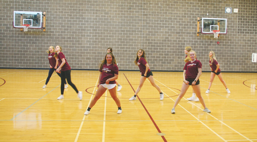 The Golden High School Demons Dance Team practice a performance routine on Jan. 8. The team's GHS Mini Poms Dance Clinic takes place from 9 a.m. to noon on Feb. 9. It is open to 100 participants in kindergarten through sixth grade.