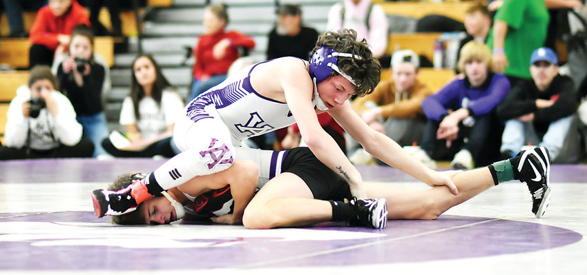 Arvada West freshman Dylan Kruse works on top during the 113-pound championship bout against Discovery Canyon's Jeff Strickenberg at the Arvada West Wrestling Invitational on Jan. 12. Kruse suffered a 5-2 loss.