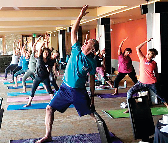 People practice yoga during Mount Vernon Canyon Club's summer wellness retreat. The Winter Wellness Retreat: RESOLUTION KICK-OFF takes place on Jan. 12.