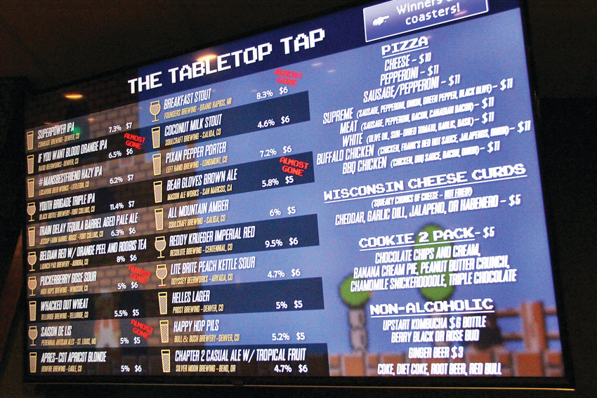 The video game-themed menu at The Tabletop Tap bar in Englewood Jan. 15. The game-filled spot in the city's downtown area offers beers on tap, bottled and canned beers and ciders, and wine.