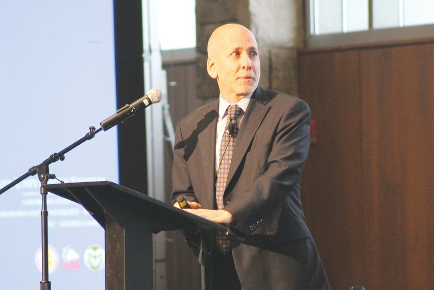 Henry Sobanet, chief financial officer of Colorado State University, speaks during the economic forecast breakfast at the CU South Denver campus in Lone Tree Jan. 18.