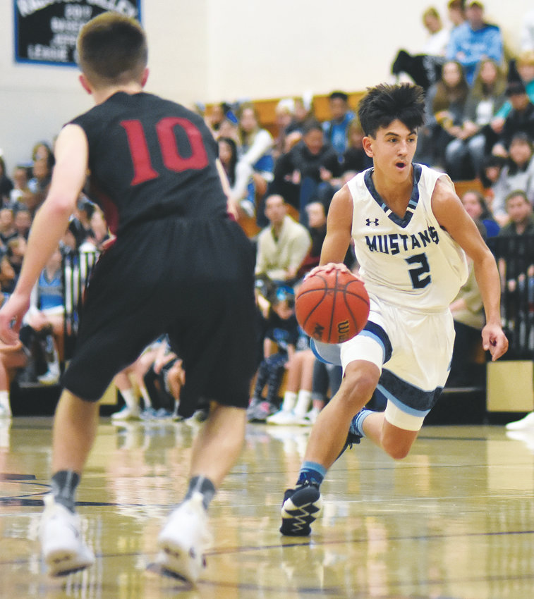 Ralston Valley junior Caden Gigstad (2) hit three 3-pointers to help the Mustangs to a 76-69 home victory Jan. 19 against Chatfield.