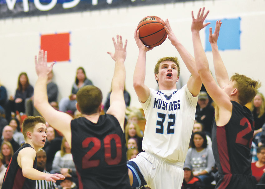 Ralston Valley junior Luke Carlston (32) had a team-high 23 points in the Mustangs' ninth straight victory Jan. 19 at Ralston Valley High School. The Mustangs defeated Chatfield 76-69 in the Class 5A Jeffco League opener for the Mustangs and Chargers.