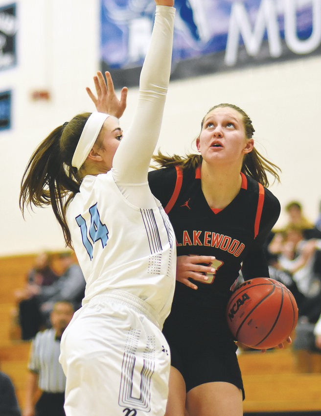 Lakewood senior Maddy Hubych, right, works inside on Ralston Valley sophomore Brooklyn Seymour (14) during the non-league game Jan. 15 at Ralston Valley High School.  The Tigers made a dozen 3-pointers, but the Mustangs came away with a 67-65 victory.