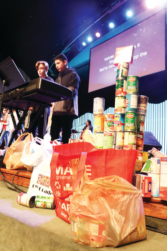 The Faith Christian Academy chapel in Arvada on Jan. 23, where student performers led the kindergarten through eighth grade student body in song, while students brought up food to donate to the hungry.