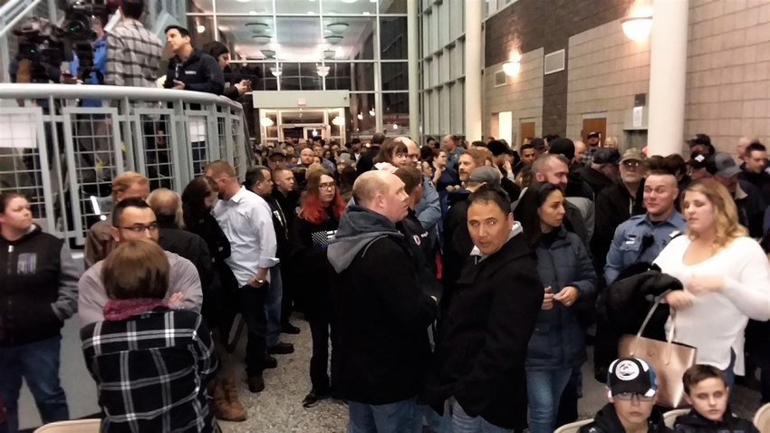 More than 250 gathered in the lobby of the Adams County Sheriff's Department Commerce City substation to honor slain Deputy Heath Gumm on the anniversary of his death.