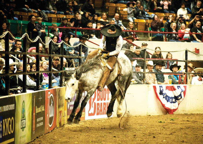 Bareback riding at the Mexican rodeo.