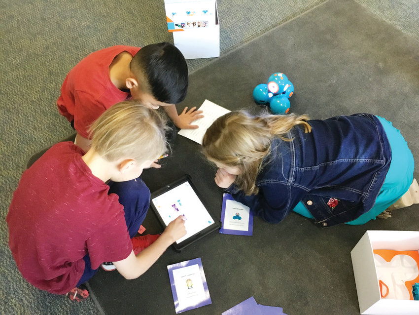 A group of third graders at Fairmount Elementary School in Golden work together on an activity called Coding Dash in the school's STEM teacher Angie Blomquist's classroom on Jan. 15.