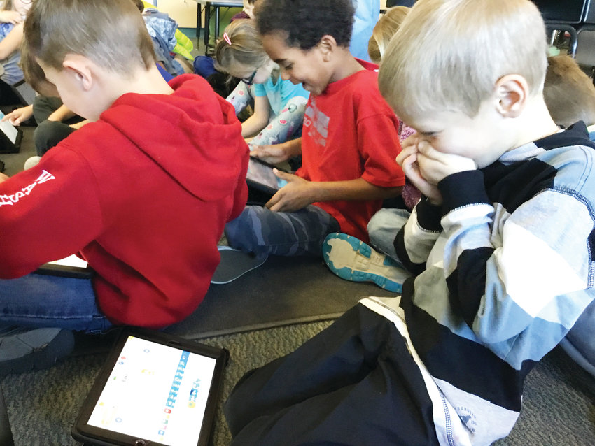 Blake Devitt, a first-grader at Fairmount Elementary School in Golden, and his fellow classmates get excited as they realize their accomplishments during a coding activity in the school's STEM classroom led by teacher Angie Blomquist on Dec. 20, 2018.