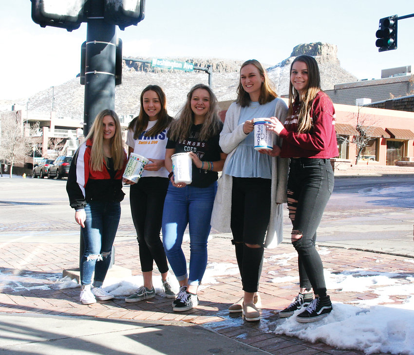 From left, Kristyn Kennedy, a senior at Lakewood High; Abbie McAdams, a junior at Wheat Ridge High; Isabella Hunt, a sophomore at Golden High; Elizabeth Becker, a senior at Ralston Valley High; and Brianna Fay, a sophomore at Ralston Valley High; gather on Washington Avenue in downtown Golden on Jan. 26 to generate conversation to raise awareness about teen mental health issues.