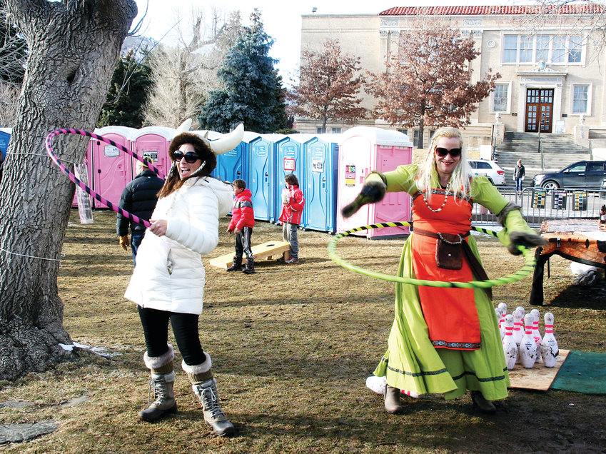 Linda Spencer and Heather Thomason Achtziger play with hula hoops on Jan. 26 in Parfet Park in downtown Golden during the fifth annual UllrGrass Music & Beer Festival. The two came with a large group from Erie to attend the festival to celebrate Shelly Miley's birthday.