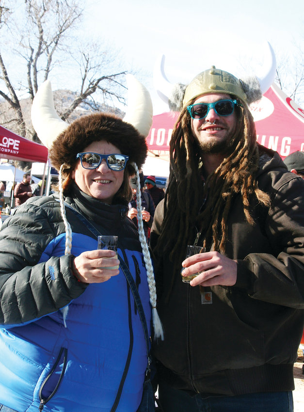 Sandi and Bryan Lauersdorf of Golden enjoy beer and cider samples and live music at UllrGrass on Jan. 26.