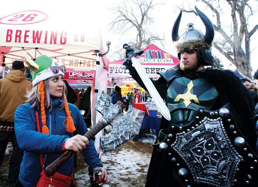 Amber Schumaker of Denver and Dane Fox of Canon City get into character and celebrate the Norse God of Winter in Parfet Park in downtown Golden.