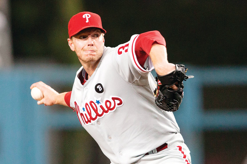 Roy Halladay is shown pitching for the Philadelphia Phillies in 2011. Halladay, who died in a plane crash in 2017, was recently elected to the Hall of Fame.
