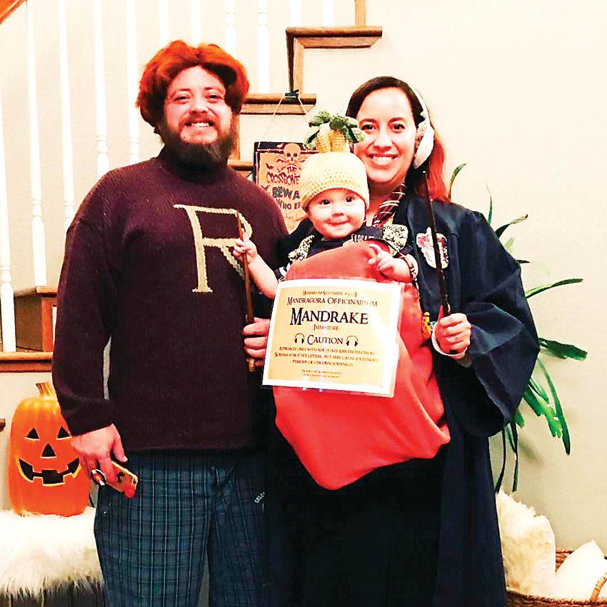 Matthew, Kim and Ruby Reeder, wearing Harry Potter costumes, celebrate Harry Potter as a family in numerous ways, Kim says. Ruby's nursery is Harry Potter themed and they attend Harry Potter themed events in the Denver metro area.