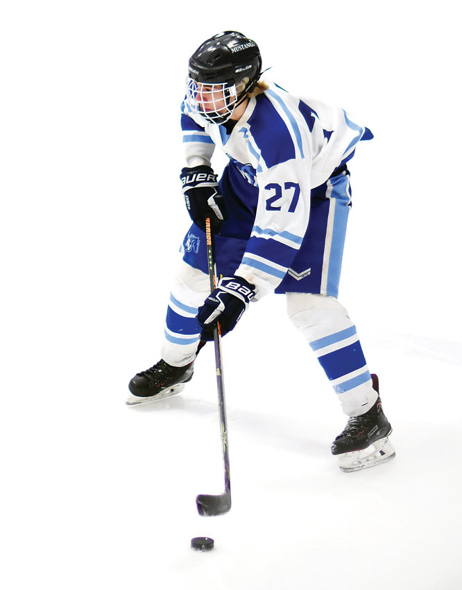 Ralston Valley forward Joseph Homer gets the puck across the blue line during a conference game against Dakota Ridge on Jan. 22 at Apex Ice Arena. The Mustangs suffered a 4-2 loss.