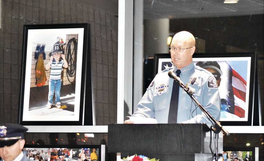 Adams County Sheriff Rick Reigenborn addresses the group during a vigil honoring slain deputy Heath Gumm Jan. 24 in his department's Commerce City Substation.