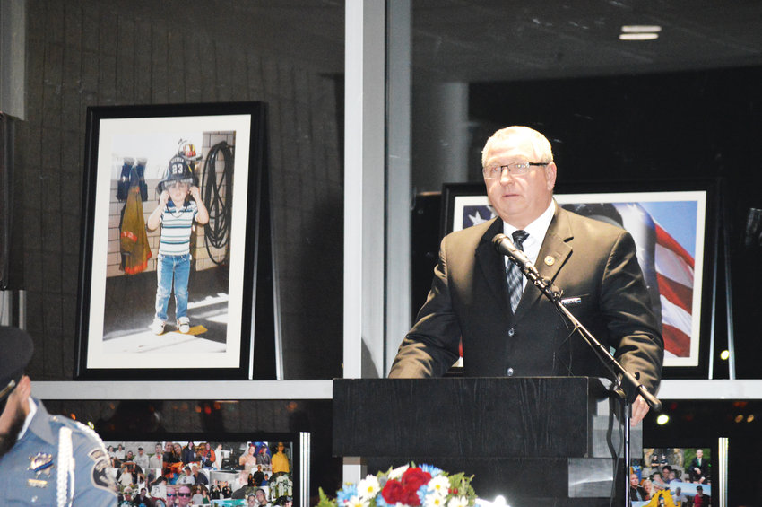 Former Adams County Sheriff Mike McIntosh speaks to the crowd during a vigil honoring slain deputy Heath Gumm on the one year anniversary of his death.