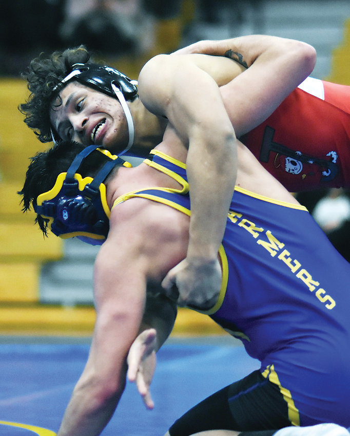 Jefferson's Alberto Zelaya, top, works on Wheat Ridge senior Jayce Chea during the 160-pound match Jan. 24 at Wheat Ridge High School. The Saints dominated the dual winning all five individual matches that were wrestled.
