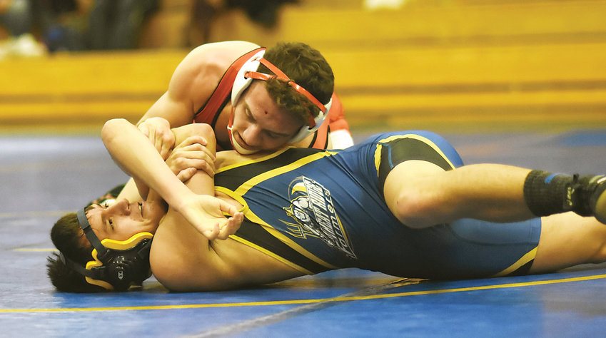 Jefferson senior Andrew Sansburn finishes off a first-period pin of Wheat Ridge's Allen Alford during a dual Jan. 24 at Wheat Ridge High School. The Saints are one of the favorites to contend for the Class 3A team state title in a couple of weeks at Pepsi Center.