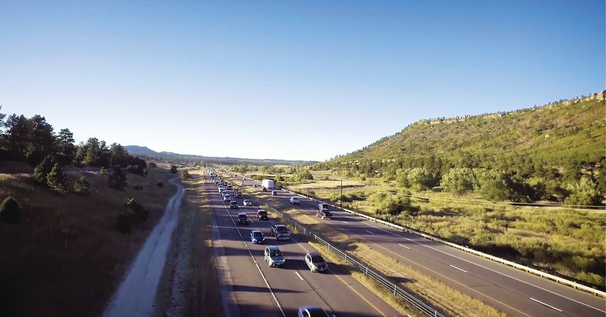 Drone footage shows traffic on Interstate 25 near Larkspur on a stretch of the roadway also known as the 'Gap.' The Colorado Department of Transportation is embarking on the next phase of construction to widen the Gap by one express lane in each direction.